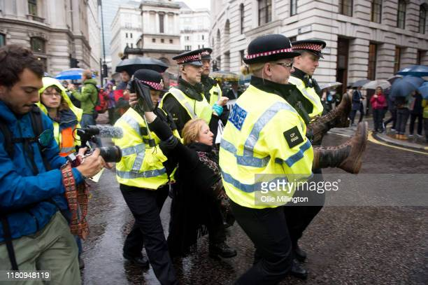 Police arrest Extinction Rebellion environmental activists protesting around Bank Junction in the financial district on the 7th day of their 'October...
