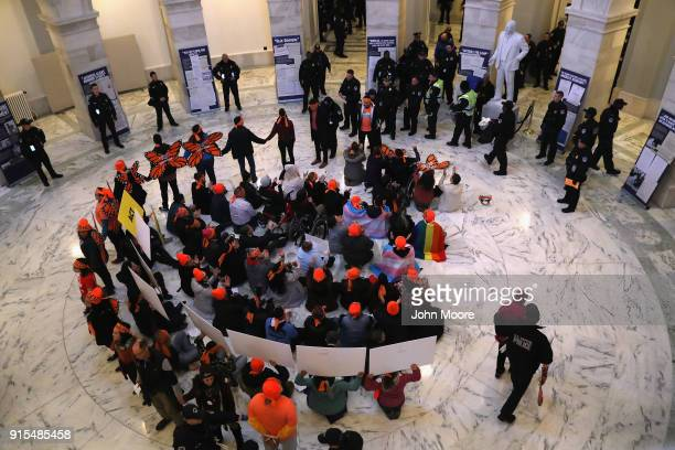 Police arrest immigration activists conducing an act of civil disobediance in the rotunda of the Russell Senate Office Building on February 7, 2018...