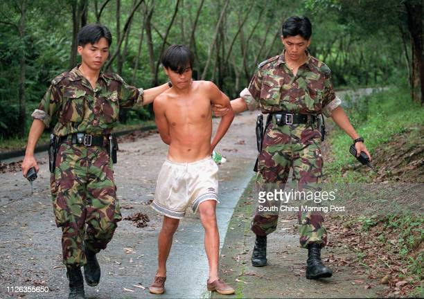 Police arrest one of 90 Vietnamese who escaped from High Island detention centre and fled into Sai Kung Country Park. Photo by Dickson Lee. 16 Jul 95