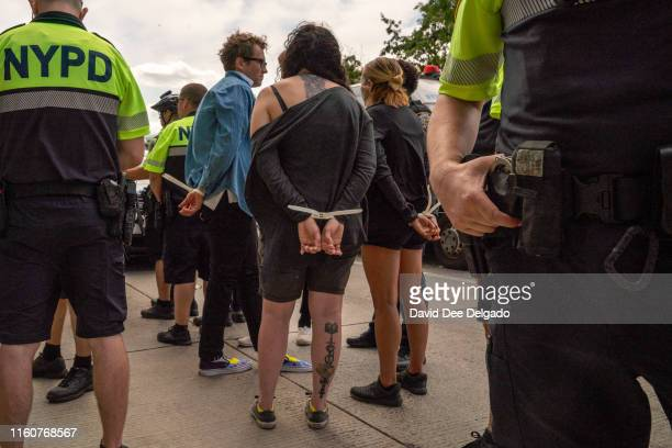 Police arrest protesters blocking the intersection of West 26 Street and 12th Avenue on August 10 2019 in New York City Protesters are demanding the...