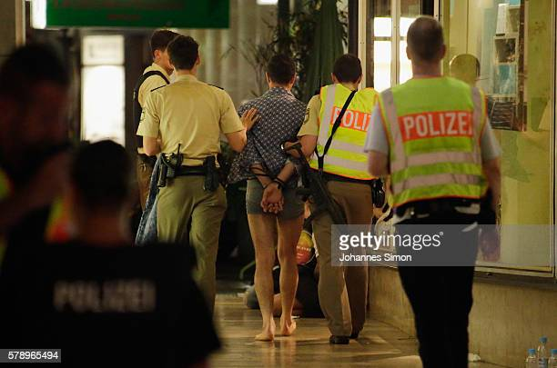 Police arrest three men whose identities and roles were not yet confirmed near Marienplatz square following a rampage shooting in the city on July 22...