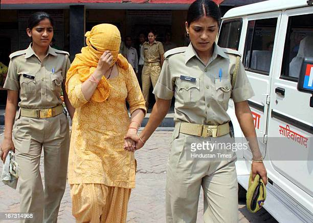 Police arrested wife of slain Delhi police constable and a neighbor on alleged charges of murder of her husband on April 24 2013 in Ghaziabad India...