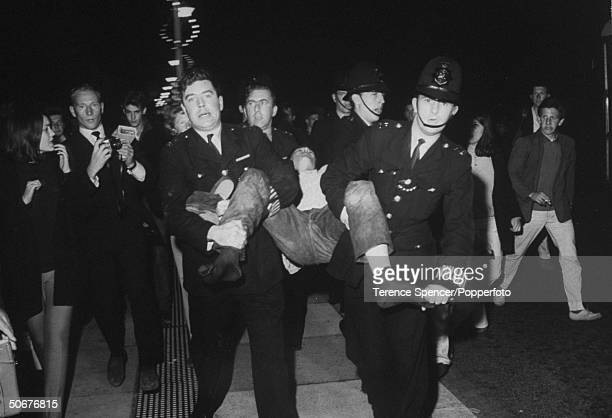 Police arresting a Rocker during a riot between the Rockers and their rivals the Mods
