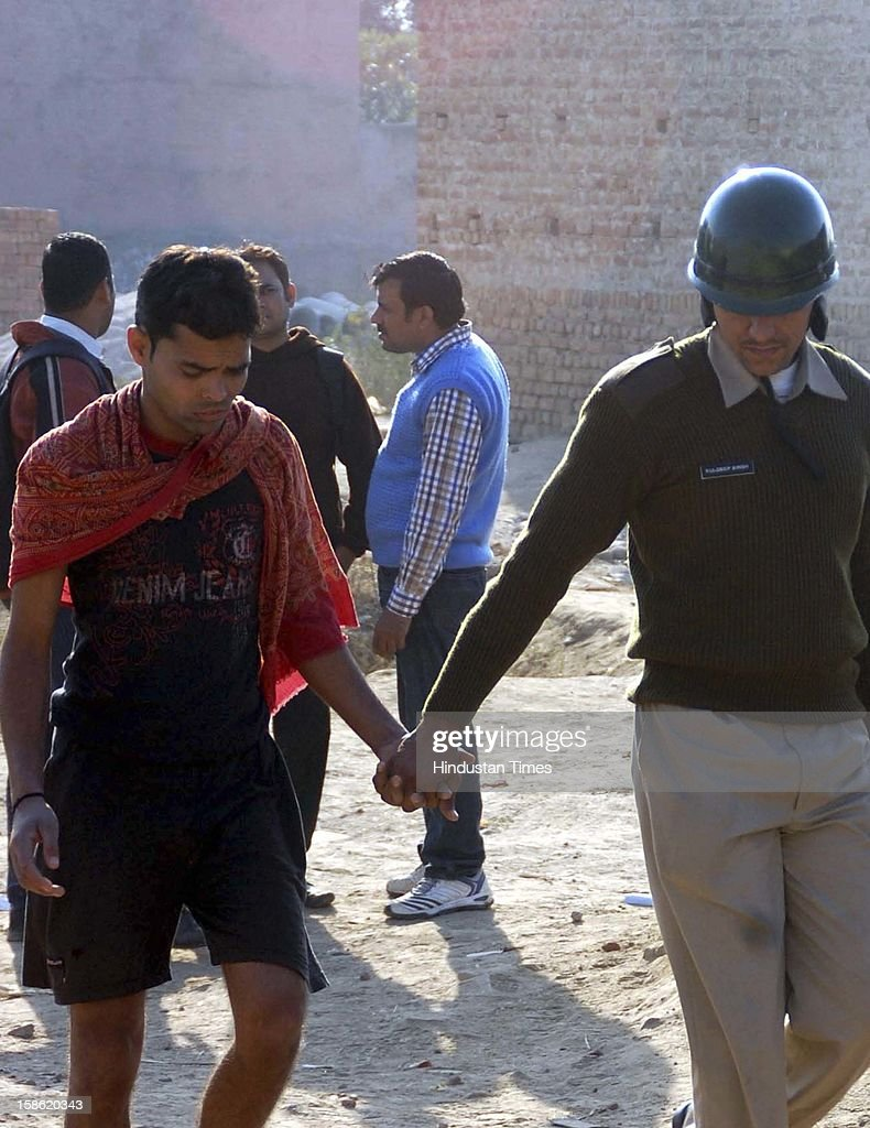 Police arresting people after clash between police and residents of Sheetla colony while demolition of illegal construction by administration on December 21, 2012 in Gurgaon, India.