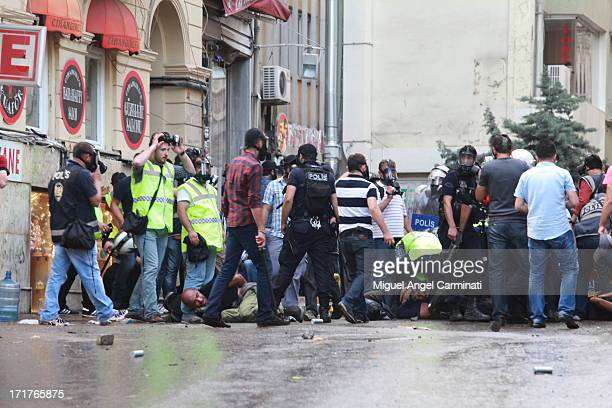 Police arresting people near Taksim Square during the riots at Istanbul.