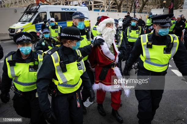 Police arresting Santa Claus during the demonstration. Lockdown protesters take to the streets again. The Save Our Rights movement, organised the...