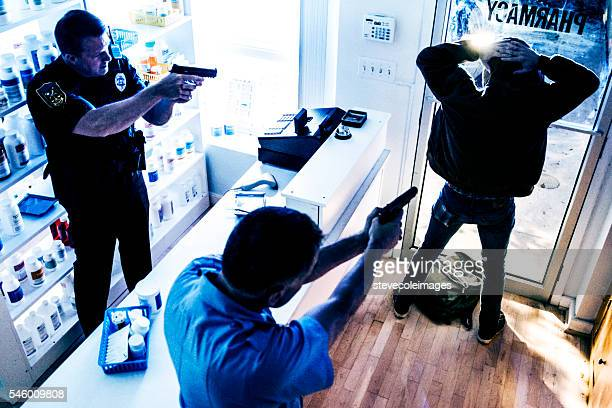 police arresting suspect - burglar stock pictures, royalty-free photos & images
