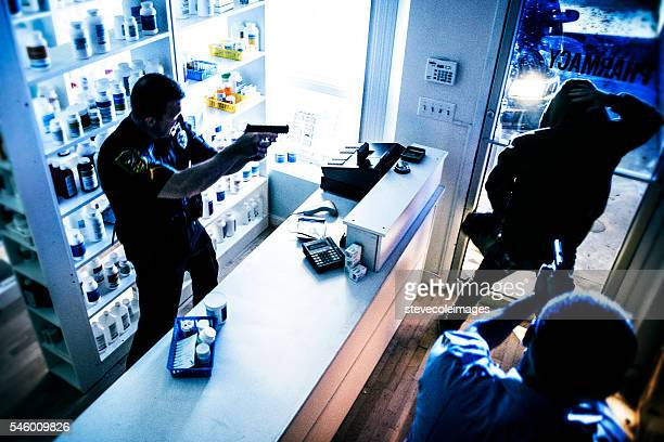 police arresting suspect - armed robbery stock photos and pictures