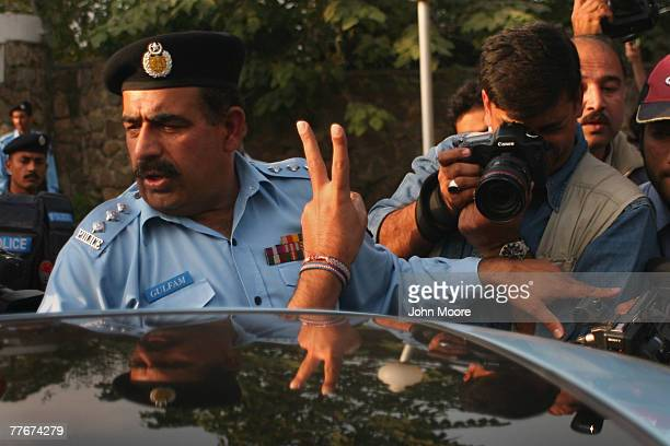 Police arrests a civil rights activist at an antigovernment protest on November 4 2007 in Islamabad Pakistan A small group of protesters held signs...