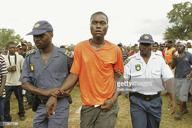 Police arrests a fihgter who stabbed another fighter during a traditional fist fighting match on December 29 2006 in Tshaulu Village Venda South...