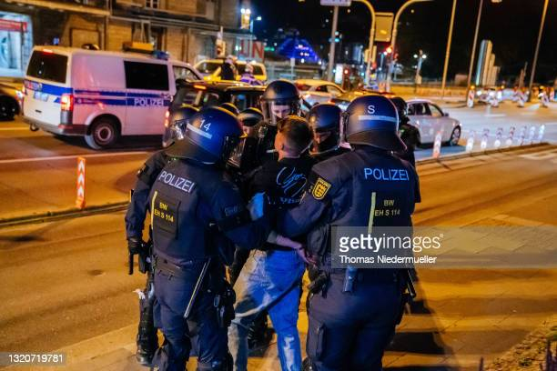 Police arrests a rioter at the first weekend after curfew at night cause of the corona virus pandemic on May 29, 2021 in Stuttgart, Germany....