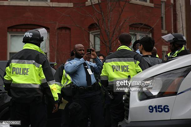 Police arrests antiTrump protesters after smashing a bank's glass in Washington USA on January 20 2017