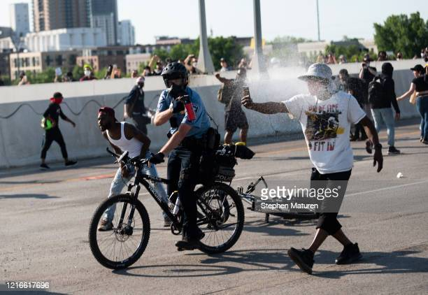 Police arrive and use pepper spray after a man drove a tanker truck into a peaceful protest on the I35W bridge over the Mississippi River on May 31...