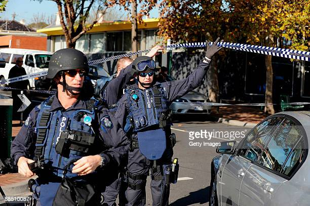 Police arrive at the crime scene where underworld figure Desmond 'Tuppence' Moran was shot dead at Ascot Vale on June 15 2009 in Melbourne Australia...