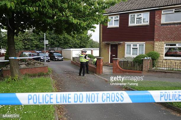 Police arrive at the scene of the suspect's home after Jo Cox Labour MP for Batley and Spen, was killed by an attacker at her constituicency on June...