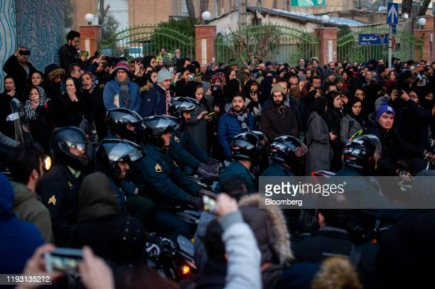 Police arrive during a vigil for the victims of the Ukraine International Airlines flight that was unintentionally shot down by Iran, in Tehran,...