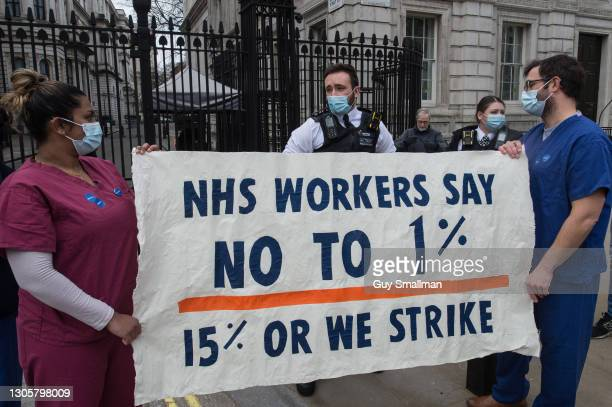 Police arrive to speak to the protesting NHS staff at Downing Street on March 7, 2021 in London, England. The Department of Health and Social Care...