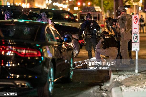 Police arrive to treat a man who was shot near a ProTrump rally on August 29 2020 in Portland Oregon Far left counterprotesters and protrump...