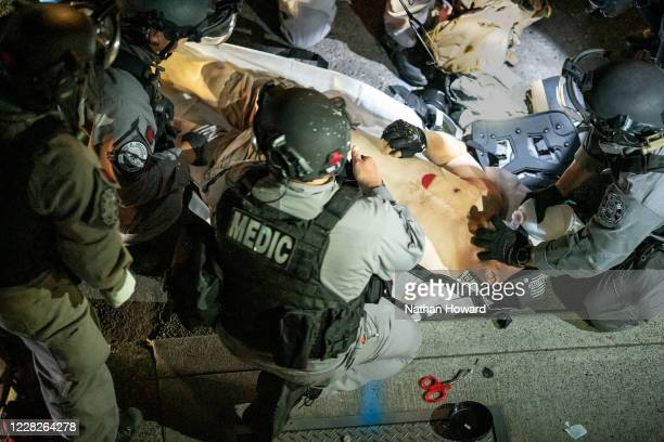 Police arrive to treat a man who was shot near a Pro-Trump rally on August 29, 2020 in Portland, Oregon. Far left counter-protesters and pro-trump...