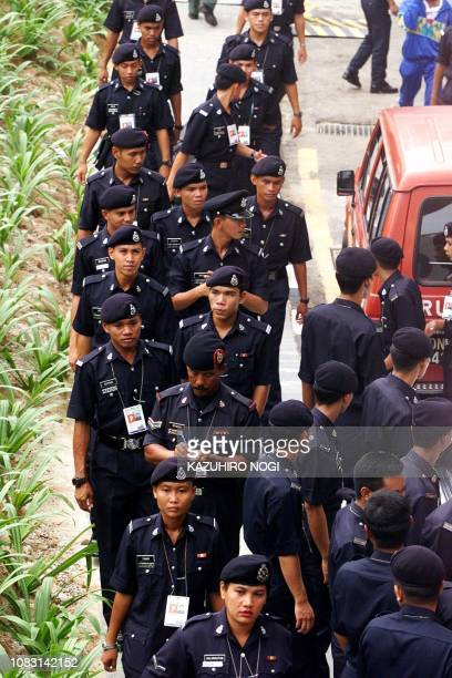 Police assemble outside the National Stadium at Bukit Jalil 21 September the site of the Athletics and Closing ceremony for the XVI Commonwealth...