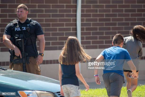 Police asses the scene outside Noblesville High School after a shooting at Noblesville West Middle School on May 25 2018 in Noblesville Indiana...