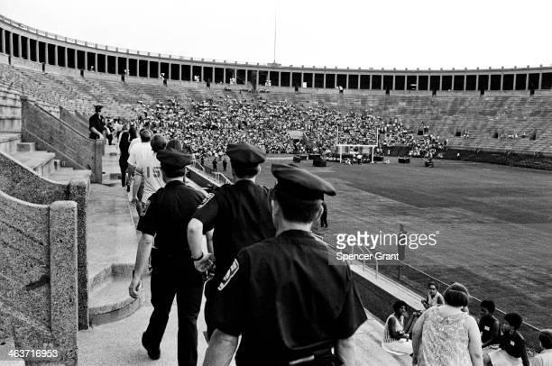 Police at Joan Baez concert at Harvard Stadium, Brighton, Massachusetts, 1969.