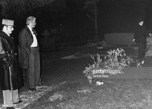 Police at the desecrated grave of English film actor and director Charlie Chaplin in the cemetery at CorsiersurVevey Switzerland March 1978 Chaplin's...