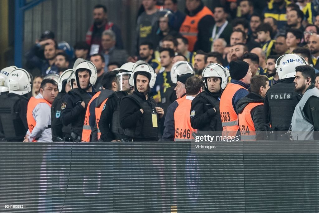 police at the end of the match during the Turkish Spor Toto Super Lig match Fenerbahce AS and Galatasaray AS at the Sukru Saracoglu Stadium on March 17, 2018 in Istanbul, Turkey