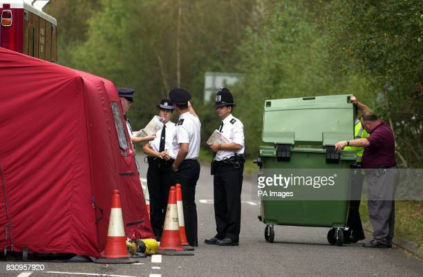 Police at the road block near Yateley Heath Minley near Fleet in Hampshire where the remains of missing schoolgirl Amanda Dowler were found * More...