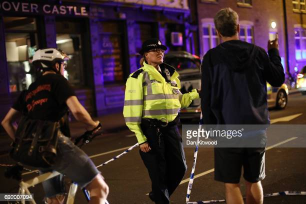 Police at the scene at Southwark Bridge after an attack on London Bridge on June 4 2017 in London England Police responded to what they are calling...