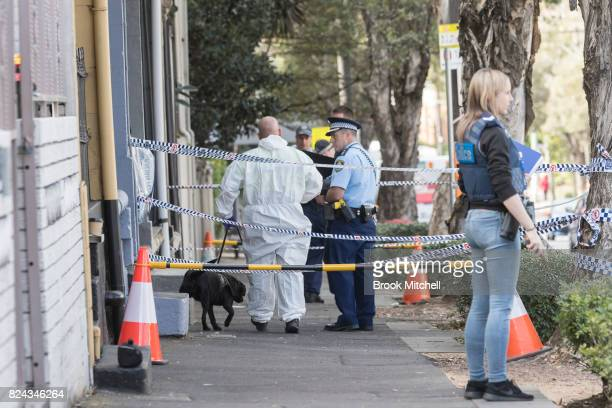 Police at the scene of overnight terror raids in Surry Hills on July 30 2017 in Sydney Australia Counter terrorism police raided four houses across...
