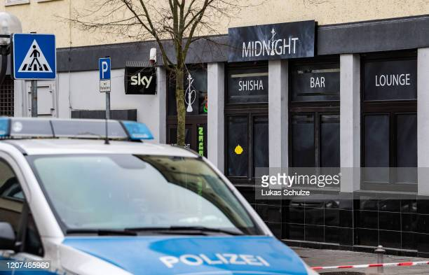 Police at the scene outside the Midnight hookah bar one of two bars that were targeted by a gunman last night on February 20 2020 in Hanau Germany A...