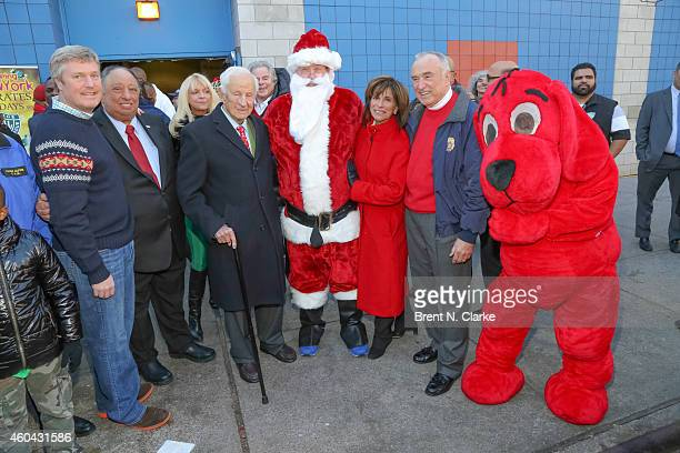 Police Athletic League board chair John Osborn PAL board members/holiday party chairs John and Margo Catsimatidis PAL honorary president Robert M...