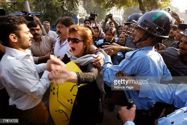 Police attempt to arrest a civil rights activist at an antigovernment protest on November 4 2007 in Islamabad Pakistan A small group of protesters...