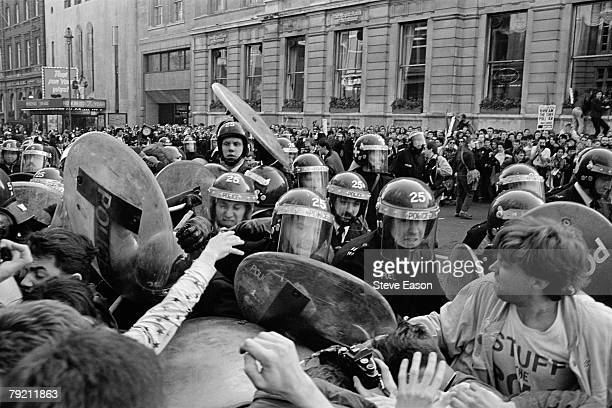 Police attempt to block off Whitehall as rioting breaks out during a demonstration against the Poll Tax London 31st March 1990