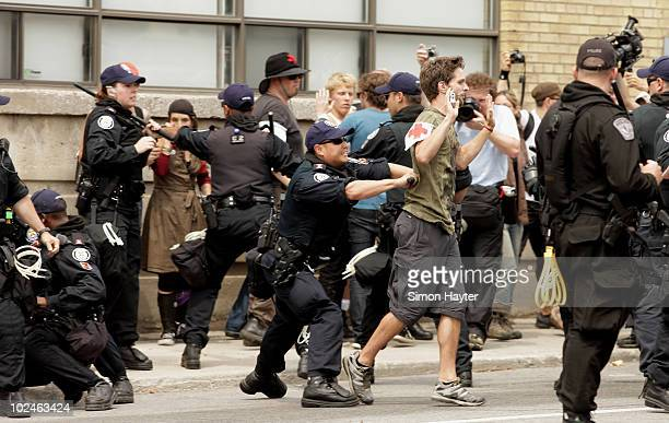 Police attempt to clear protestors and make several arrests at a rally outside the temporary G20 police detention center where over 500 people are...