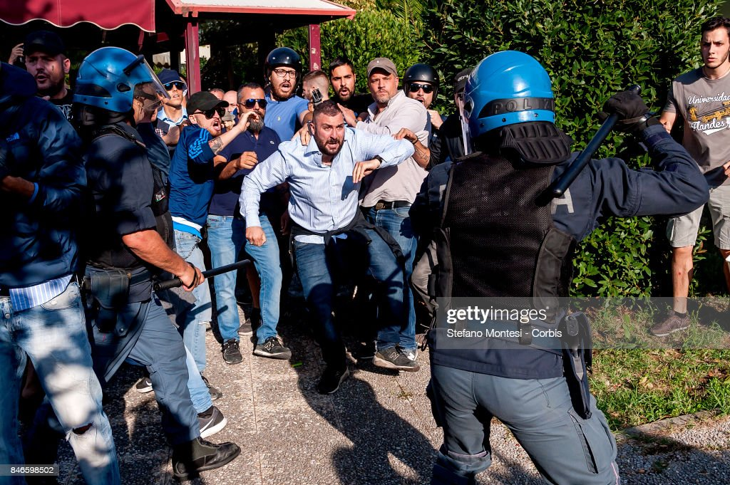 Police attempt to control Casapound's extreme right-wing militants as they clash with the anti-fascists in front of the Fourth Town Hall, where the future of a centre for refugees was discussed on September 13, 2017 in Rome, Italy. Far right movement Casapound are demanding the closure of the centre which is run by the Red Cross in District Tiburtino IV in Rome.