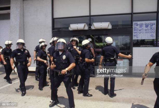 Police attempt to restore order at the Vons grocery store at 3461 W 3rd Street during widespread riots that erupted after the acquittal of 4 LAPD...