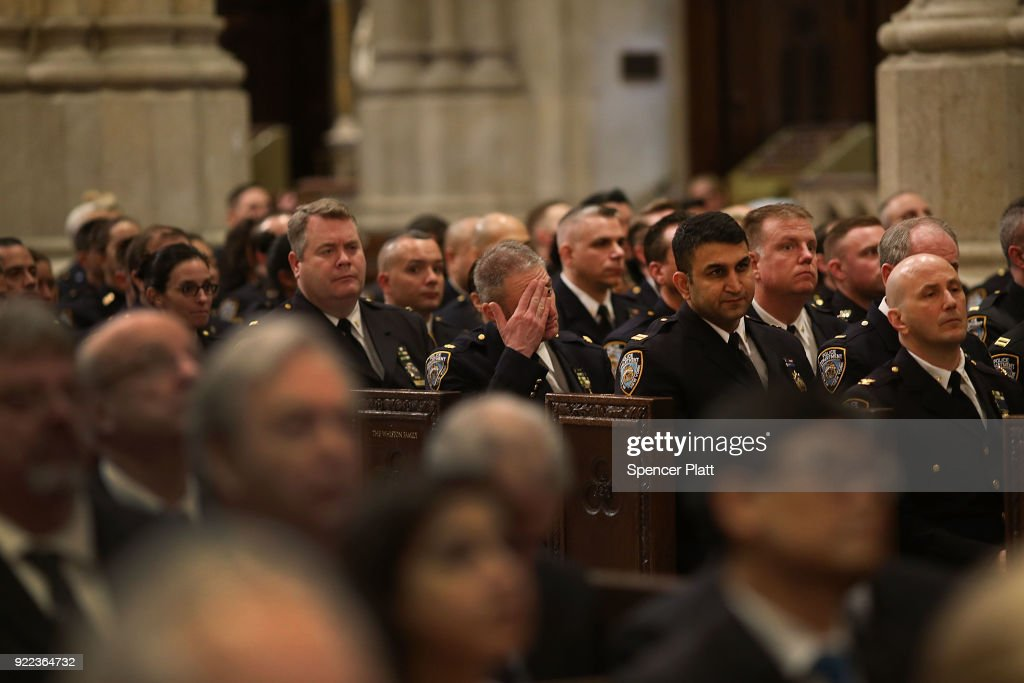 Police attend a service at St. Patrick's Cathedral as a memorial Mass is held for NYPD Officer Edward Byrne almost 30 years after he was executed by a drug gang on February 21, 2018 in New York City. The murder of the 22 year old officer, by a notorious drug dealer Howard (Pappy) Mason as he guarded the Queens home of a witness, shocked the city for its brutality.