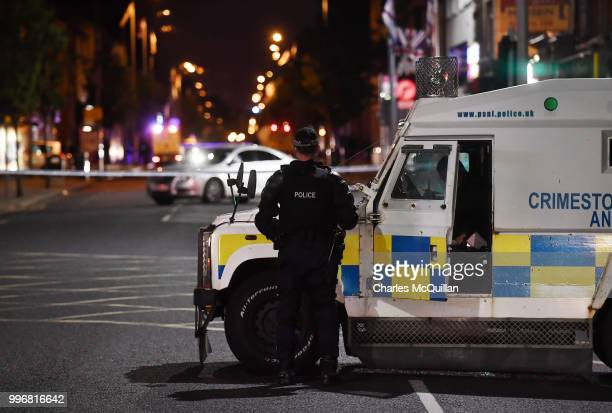 Police attend a suspect device left inside a car on the Newtownards road on July 11 2018 in Belfast Northern Ireland Police have asked for calm after...