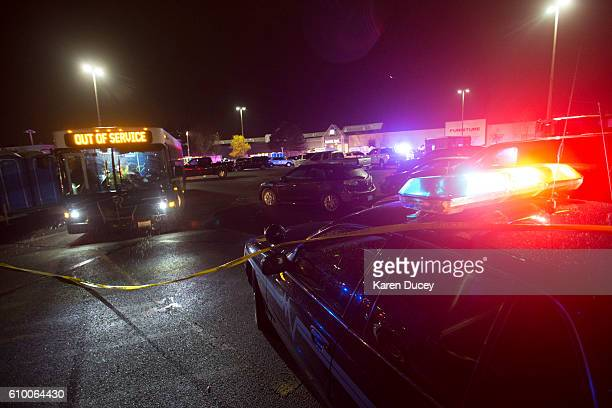 Police attend the Cascade Mall after three women were reportedly shot dead and a man critically injured following a shooting at the shopping center...
