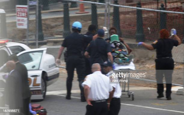 Police attend to injured person at the US Capitol October 3 2013 on Capitol Hill in Washington DC The US Capitol and the White House were placed on...