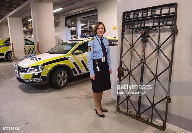Police Attorney Kari Bjoerkhaug Trones is pictured on December 03 2016 in Bergen Norway beside the iron gate from the former Nazi concentration camp...