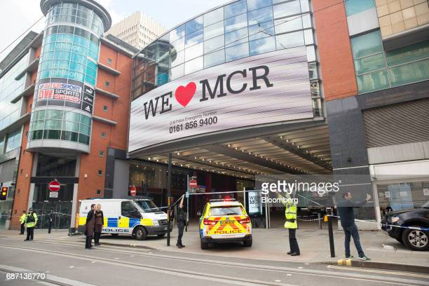 A police automobile enters the cordon following an evacuation at the Arndale shopping mall in Manchester UK on Tuesday May 23 2017 At least 22 people...