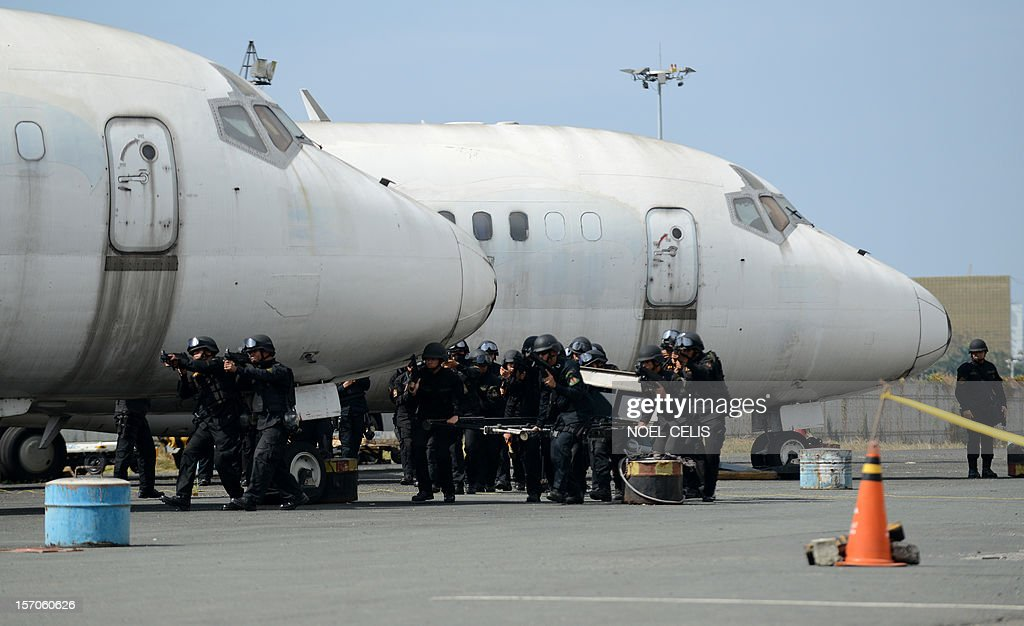 Police Aviation participate in the Philippine National Police (PNP) capability demonstration at the Manila International Airport in Manila on November 28, 2012. The drill is part of the security plan in anticipation of a possible rise in crimes during the coming Christmas season. The Philippines has the longest Christmas season in the world, which officially begins with nine pre-dawn masses nine days before December 25 and typically extends to the first week of January.