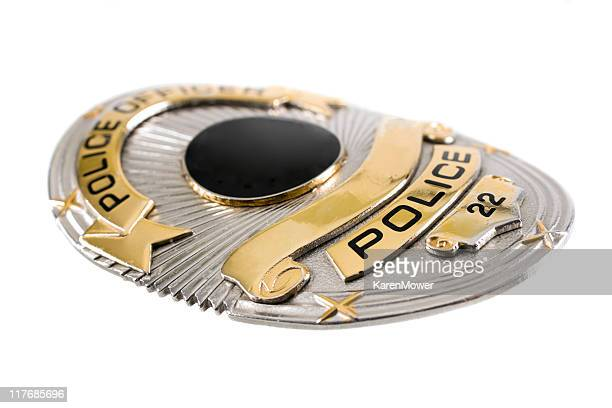 A police badge against a white background