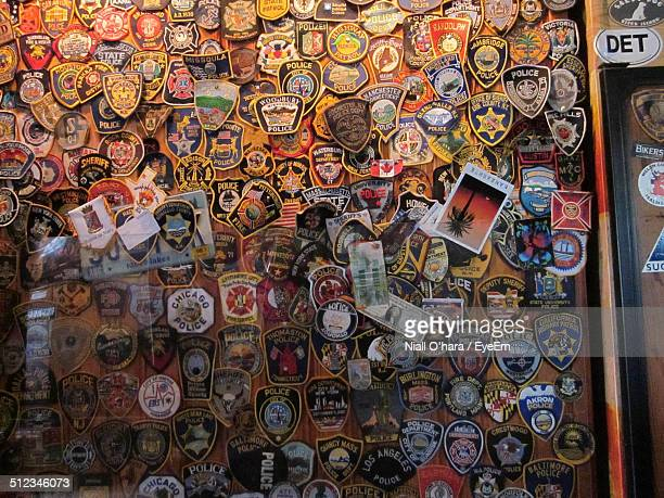 Police badges displayed on wall