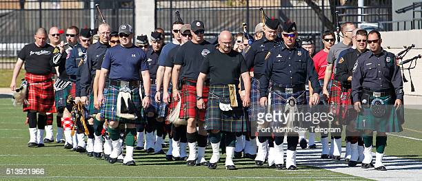 Police bagpipers from different departments practice on the field before a memorial service at Pennington Field in Fort Worth Texas for Euless Texas...