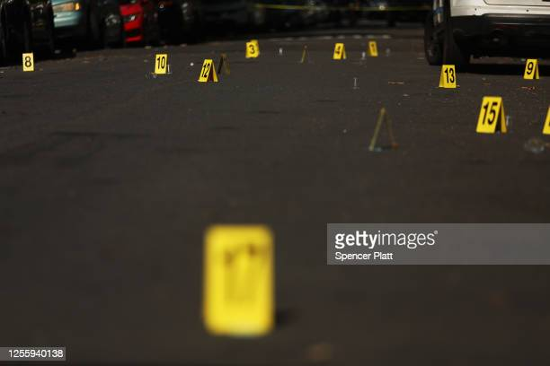 Police ballistic markers stand at a crime scene in Brooklyn where a one year old child was shot and killed on July 13, 2020 in New York City. The...