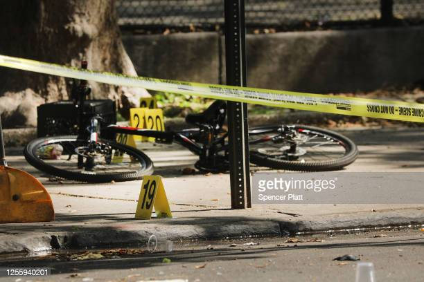 Police ballistic markers stand besides a child's bicycle at a crime scene in Brooklyn where a one year old child was shot and killed on July 13, 2020...